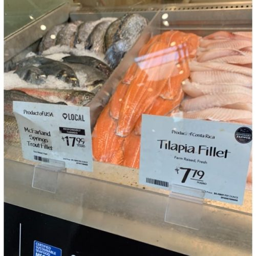 Fish at a seafood counter with country of origin clearly visible