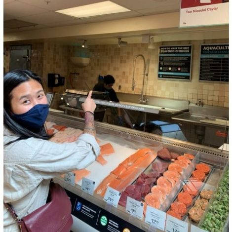 seafood_counter_person_pointing